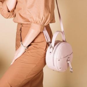 Компактная круглая сумка в розовой коже